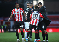 Luka Racic of Brentford hugs Said Benrahma at the final whistle to celebrate their 3-2 victory during Brentford vs Middlesbrough, Sky Bet EFL Championship Football at Griffin Park on 8th February 2020
