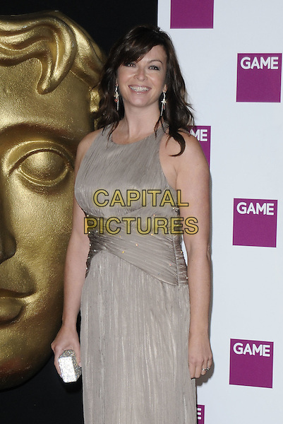 SUZI PERRY .At the British Academy Video Games Awards, London HIlton Hotel, Park Lane, London, England, UK, March 19th 2010..BAFTA half length sleeveless beige dress taupe brown .CAP/CAN.©Can Nguyen/Capital Pictures