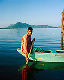 SRI LANKA, Dambulla, Asia, portrait of a fisherman sitting on boat at Kandalama lake