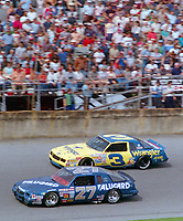 Rusty Wallace (#27) and Dale Earnhardt (#3) race down the frontstretch at Daytona during the 1986 Daytona 500.(Photo by Brian Cleary)