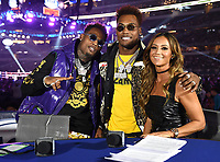 DALLAS, TX - MARCH 16: Fox's Kate Abdo with Jermall and Jermell Charlo at the Errol Spence Jr. vs Mikey Garcia IBF  World Welterweight Championship at the Fox Sports PBC Pay-Per-View fight night at AT&T Stadium on March 16, 2019 in Dallas, Texas. (Photo by Frank Micelotta/Fox Sports/PictureGroup)