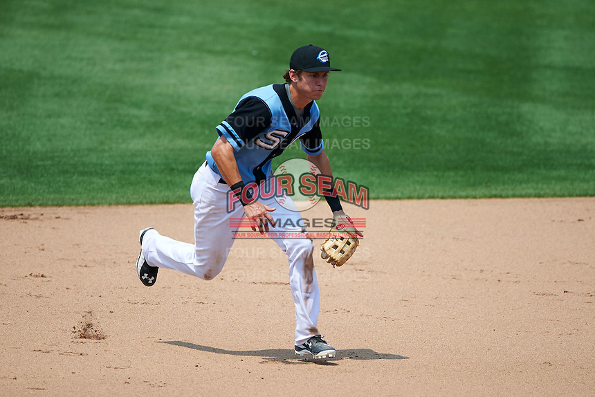 Syracuse Chiefs shortstop Trea Turner (4) fields a ground ball during a game against the Pawtucket Red Sox on July 6, 2015 at NBT Bank Stadium in Syracuse, New York.  Syracuse defeated Pawtucket 3-2.  (Mike Janes/Four Seam Images)