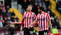 Lincoln City's Cian Bolger, left, and Lincoln City's Michael Bostwick<br /> <br /> Photographer Chris Vaughan/CameraSport<br /> <br /> The EFL Sky Bet League Two - Lincoln City v Grimsby Town - Saturday 19 January 2019 - Sincil Bank - Lincoln<br /> <br /> World Copyright © 2019 CameraSport. All rights reserved. 43 Linden Ave. Countesthorpe. Leicester. England. LE8 5PG - Tel: +44 (0) 116 277 4147 - admin@camerasport.com - www.camerasport.com