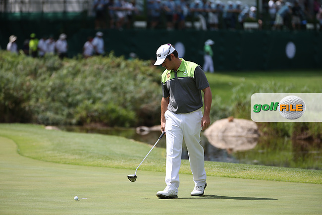 Should have been a birdie all the way for Louis Oosthuizen (RSA) but maybe his rhythm was upset waiting for Thongchai Jaidee (THA) to clear the green during the Final Round of the 2014 Nedbank Golf Challenge at the Gary Player Country Club, Sun City Resort, South Africa. Picture:  David Lloyd / www.golffile.ie
