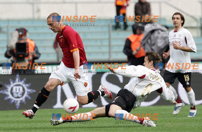 Daniele De Rossi (Roma), Luca Tognozzi (Reggina)<br /> Italian &quot;Serie A&quot; 2006-07<br /> 25 Feb 2007 (Match Day 25)<br /> Roma-Reggina (3-0)<br /> &quot;Olimpico&quot;-Stadium-Roma-Italy<br /> Photographer: Andrea Staccioli INSIDE