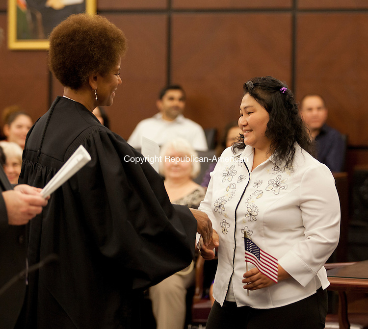 HARTFORD, CT-11 July 2014-071114BF06- Native Karen and former refugee June Nee Ta, 32, meets judge Vanessa Bryant during a naturalization ceremony in U. S. District Court in Hartford Friday. Four former refugees from Burma have resided in Waterbury for seven years and became United States citizens Friday. Bob Falcetti Republican-American