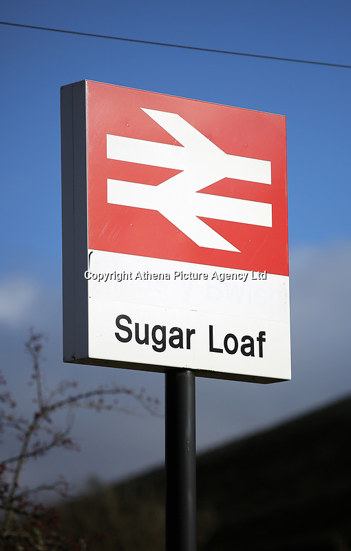 The sign of Sugar Loaf railway station, the most remote station on the Heart of Wales Line, situated by the A483 road, Powys, Wales, UK. Friday 01 December 2017