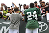 Ryan Fitzpatrick #14, New York Jets starting quarterback, left, and cornerback #24 Darrelle Revis sign autographs for fans after a day of team training camp at Atlantic Health Jets Training Center in Florham Park, NJ on Tuesday, Aug. 2, 2016.