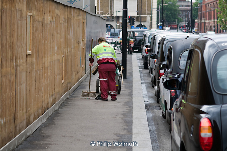 A street cleaner employed by private contractor Veolia outside St.Pancras International station.