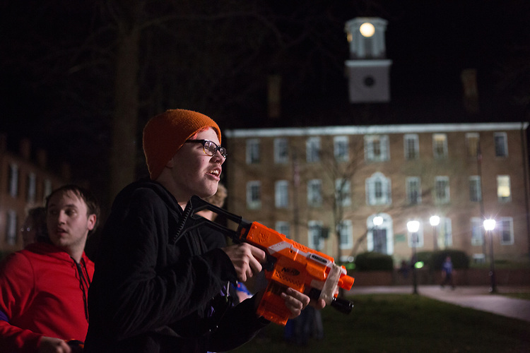 Justin Mooney, an Athens resident, watches for zombies during a Humans vs. Zombies game on March 22, 2017.