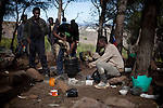 Sub-saharan immigrants cook roots in the Gurugu Mountain, waiting to jump the border fence that separates the Spanish city of Melilla from Morocco, on november 2, 2012, some of them are there since two years ago..