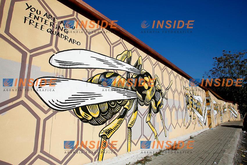 Titolo: Nido di vespe,  Artista Lucamaleonte<br /> Title Wasp's nest, Artist Lucamaleonte<br /> Nido di vespe era lo sprezzante appellativo con cui il comandante Kappler, responsabile dell'eccidio delle Fosse Ardeatine, chiamava il Quadraro. Nonostrante la deportazione di migliaia di uomini della zona, il quartiere non cedette, compatto, come un nido di vespe. Questo murale e' un omaggio a quella gente, al loro coraggio, al loro spirito laborioso e alla loro volont&agrave;' di resistenza. <br /> <br /> Mural to commemorate the roundup of thousands of citizens of Quadraro quarter in 1944 by the nazis<br /> Nazi Capitan Keppler was used to call the Quadraro quarter wasp's nest because of the intense resistance against nazis<br /> Roma 01-02-2015 Street Art a Roma. In vari quartieri di Roma e' fiorita la Street Art, con splendidi murales che hanno lo scopo di raccontare delle storie della citta', di commemorare dei momenti importanti, o semplicemente di interpretarla.<br /> Street Art in Rome. Very important writers  painted Murales in various districts of Rome to tell stories about the city, to commemorate important moments, to embellish the quarter or simply to portray it.  <br /> Photo Samantha Zucchi Insidefoto