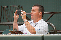Winston-Salem Journal sports writer John Dell uses his iPhone to capture video towards the end of the Carolina League baseball game between the Wilmington Blue Rocks and the Winston-Salem Dash at BB&T Ballpark on June 10, 2012 in Winston-Salem, North Carolina.  The Dash defeated the Blue Rocks 2-0.  (Brian Westerholt/Four Seam Images)