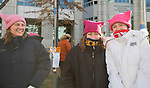 Cassie Grieve, Joni Lee Carroll and Max Grieve during the Reno Women's March on Washington event on Virginia Street in downtown Reno on Saturday, Jan. 21, 2017.