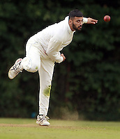 Majid Akram bowls for South Hampstead during the Middlesex County Cricket League Division Three game between Highgate and South Hampstead at Park Road, Crouch End on Sat Aug 2, 2014