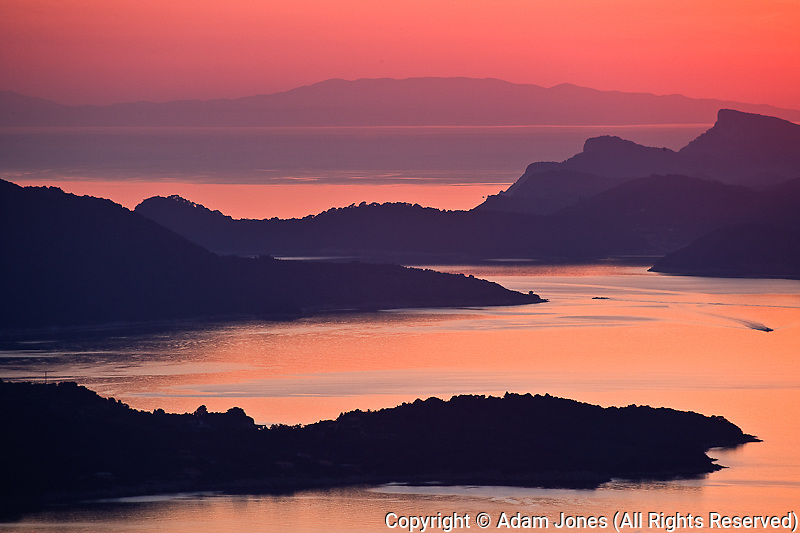 Sunset over islands in the Adriatic Sea off Dubrovnik, Croatia, a UNESCO World Heritage Site