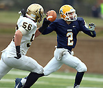 SIOUX FALLS, SD - NOVEMBER 16: Trey Heid #2 from Augustana looks to make a pass while being chased by JJ Bobrowicz #56 from Southwest Minnesota State in the second quarter of their game Saturday at Augustana. (Photo by Dave Eggen/Inertia)