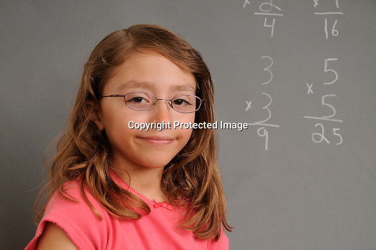 Child in front of Chalk board
