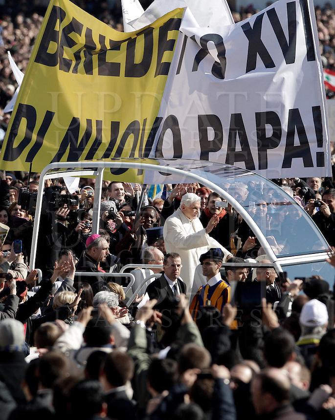 "Papa Benedetto XVI tiene la sua ultima udienza generale del mercoledi' alla vigilia del suo ritiro dal Pontificato, in Piazza San Pietro, Citta' del Vaticano, 27 febbraio 2013..Pope Benedict XVI attends his last general Wednesday audience on the eve of his retirement from the Papacy, in St. Peter's square at the Vatican, 27 February 2013. The banner reads, in Italian, ""Benedict XVI newly Pope!""..UPDATE IMAGES PRESS/Riccardo De Luca -STRICTLY FOR EDITORIAL USE ONLY-"