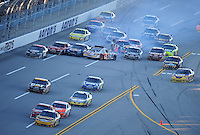 Nov. 1, 2009; Talladega, AL, USA; NASCAR Sprint Cup Series driver Jamie McMurray (26) leads the field as Scott Speed (82) and Martin Truex Jr (1) crash in a multi car accident during the Amp Energy 500 at the Talladega Superspeedway. Mandatory Credit: Mark J. Rebilas-