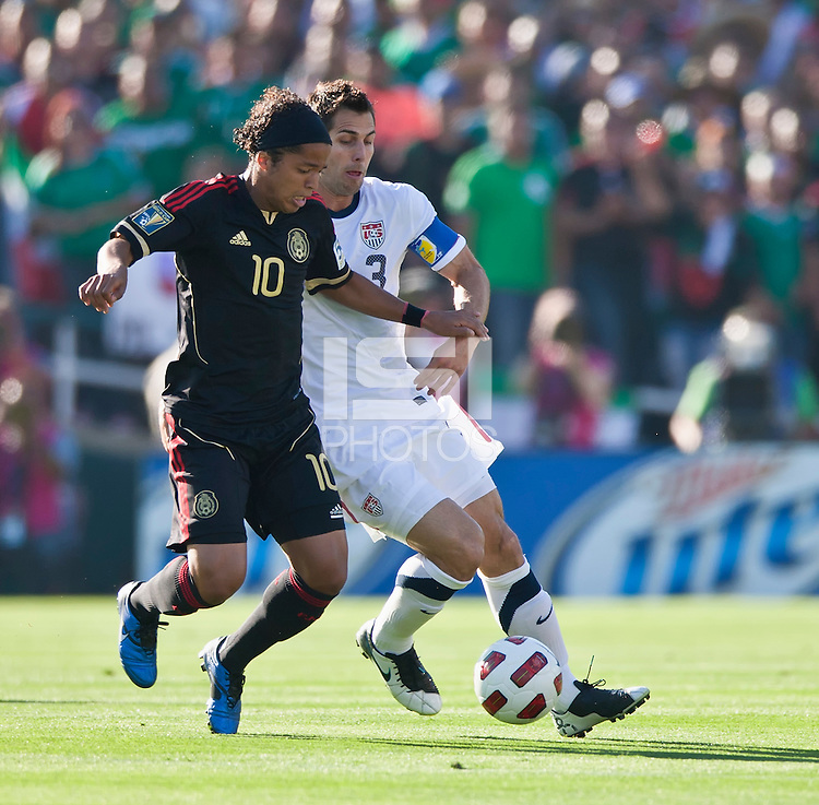 PASADENA, CA – June 25, 2011: USA player Carlos Bocanegra (3) and Mexico player Giovani Dos Santos (10) during the Gold Cup Final match between USA and Mexico at the Rose Bowl in Pasadena, California. Final score USA 2 and Mexico 4.