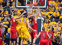 David Kravish of California tries to knock the ball away from Kaleb Tarczewski of Arizona during the game at Haas Pavilion in Berkeley, California on February 1st, 2014.  California Golden Bears defeated Arizona Wildcats, 60-58.