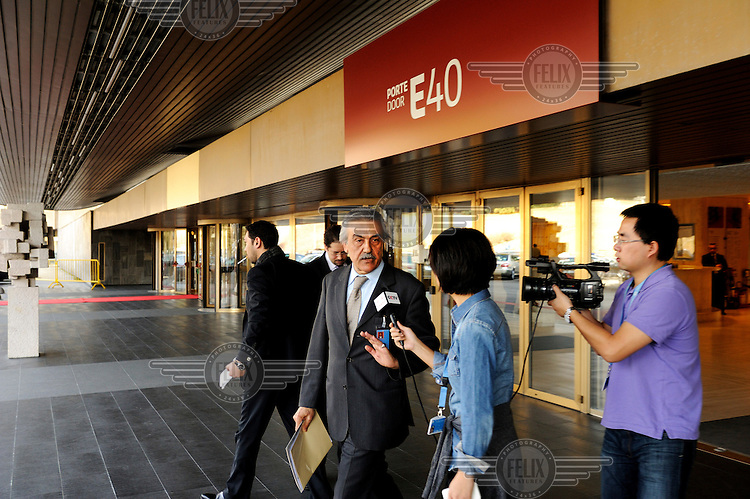 The Syrian ambassador to the UN, Fayssal Al-Hamwi, is interviewed by a TV crew as he leaves the emergency debate on Syria held at the United Nations Human Rights Council in Geneva. The debate was called in response to the worsening crisis in Syria where anti government forces, led by the Free Syrian Army (FSA), are fighting the Assad regime across the country and allegations of human rights abuses are proliferating. Al-Hamwi accused the council of promoting terrorism before leaving the meeting prematurely. .