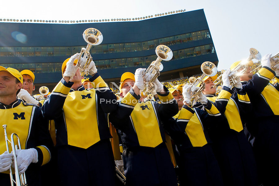 Trumpeters of the Michigan Marching Band keep the volume up during the season opener against Western Michigan, Saturday, Sept. 3, 2011 in Ann Arbor, Mich. (Tony Ding for The New York Times)