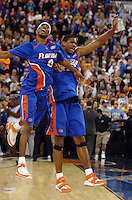 Florida basketball players Corey Brewer and Al Horford jump in joyous celebration following the Gators' victory over the UCLA Bruins in the NCAA Basketball Championship Game at the RCA Dome in Indianapolis, Indiana.(Rick Wilson/The Florida Times-Union)