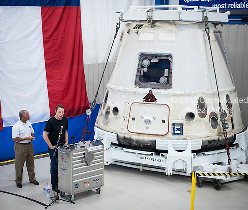 NASA Administrator Charles Bolden, left, and SpaceX CEO and Chief Designer Elon Musk, view the historic Dragon capsule that returned to Earth on May 31 following the first successful mission by a private company to carry supplies to the International Space Station on Wednesday, June 13, 2012 at the SpaceX facility in McGregor, Texas.  Bolden and Musk also thanked the more than 150 SpaceX employees working at the McGregor facility for their role in the historic mission. .Mandatory Credit: Bill Ingalls / NASA via CNP