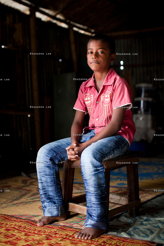 "Oli Ahmed (11) sits for a portrait in the meeting hut of a Children's Group in Bhashantek Basti (Slum) in Zon H, Dhaka, Bangladesh on 23rd September 2011. Oli says, ""We are in extreme poverty. If our parents get a good price for our marriages, there is nothing we can do. (Also,) we are now in the era of gender equality and girls should be allowed to study instead of being married off."" Oli wants to be a doctor when he grows up. The Bhashantek Basti Childrens Group is run by children for children with the facilitation of PLAN Bangladesh and other partner NGOs. Slum children from ages 8 to 17 run the group within their own communities to protect vulnerable children from child related issues such as child marriage. Photo by Suzanne Lee for The Guardian"