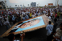 Mourners gather as large portrait of the late former Cambodian King Norodom Sihanouk is placed in front of the Royal Palace in Phnom Penh October 16, 2012. Norodom Sihanouk, once an absolute ruler who freed Cambodia from colonialism before becoming a tragic pawn through decades of turmoil, died on Monday in a Beijing hospital. He was 89. REUTERS/Damir Sagolj (CAMBODIA)
