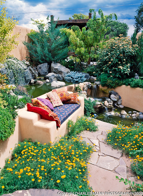 Susan Blevins of Taos, New Mexico, created an elaborate home garden featuring containers, perennial beds, a Japanese themed path and a regional style that reflects the Spanish and pueblo architecture of the area. Exotic pillows add to a colorful sunken niche with a waterfall an orange poppies.