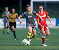 Amy Rodriguez, Brittany Bock. The Western New York Flash defeated the Philadelphia Independence, 2-1, during the game at Quick Stadium in Chester, PA.