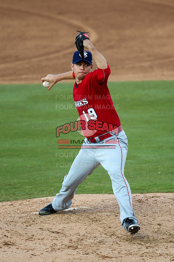 Oklahoma City RedHawks pitcher Brian Bass #19 delivers during the Pacific Coast League baseball game against the Round Rock Express on June 15, 2012 at the Dell Diamond in Round Rock, Texas. The Express shutout the RedHawks 2-1. (Andrew Woolley/Four Seam Images).