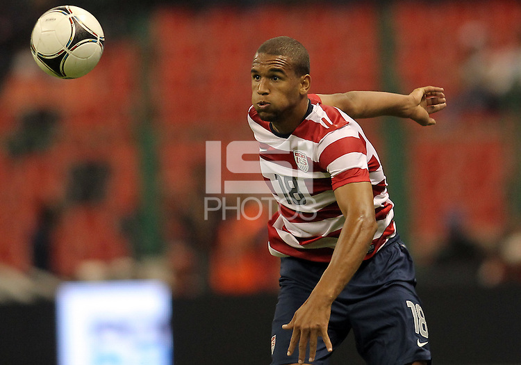 MEXICO CITY, MEXICO - AUGUST 15, 2012:  Terrence Boyd (18) of the USA MNT goes for a high ball against  Mexico during an international friendly match at Azteca Stadium, in Mexico City, Mexico on August 15. USA won 1-0.