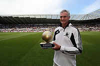 Pictured: Groundsman Dan Duffy with his Premier League Award for the Liberty Stadium pitch. Sunday 04 May 2013<br />