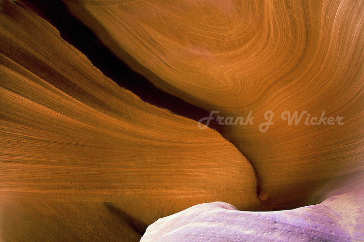 Sensuous flowing lines of sandstone erosion in Lower Antelope Canyon near Lake Powel and Page Arizona