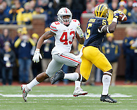 Ohio State Buckeyes linebacker Darron Lee (43) pursues Michigan Wolverines running back Jabrill Peppers (5) during the NCAA football game at Michigan Stadium in Ann Arbor on Nov. 28, 2015. Ohio State won 42-13. (Adam Cairns / The Columbus Dispatch)