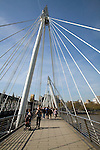People crossing the Golden Jubilee bridge, London