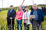 Enjoying the Races in Cahersiveen on Sunday were l-r; John Griffin, Róisín & Helen Kissane with Mike McCarthy studying the race Card.