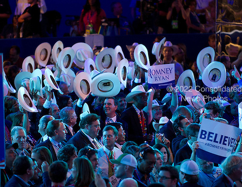 Texas delegation wave their hats to the music at the 2012 Republican National Convention in Tampa Bay, Florida on Thursday, August 30, 2012.  .Credit: Ron Sachs / CNP.(RESTRICTION: NO New York or New Jersey Newspapers or newspapers within a 75 mile radius of New York City)