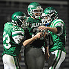 Seaford No. 32 Frank Lauretti, center, celebrates with teammates No. 23 Danny Roell, left, and No. 51 Jack Lasher after Roell ran for a touchdown in the second quarter of a Nassau County varsity football Conference IV semifinal against Clarke at Hofstra University on Thursday, Nov. 12, 2015. Seaford went to halftime leading 42-0.<br /> <br /> James Escher