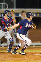 Evan Stephens #13 (Wake Forest) of the High Point-Thomasville HiToms follows through on his swing against the Wilson Tobs at Finch Field on June 17, 2013 in Thomasville, North Carolina.  The Tobs defeated the HiToms 3-2 in 11 innings.  Brian Westerholt/Four Seam Images