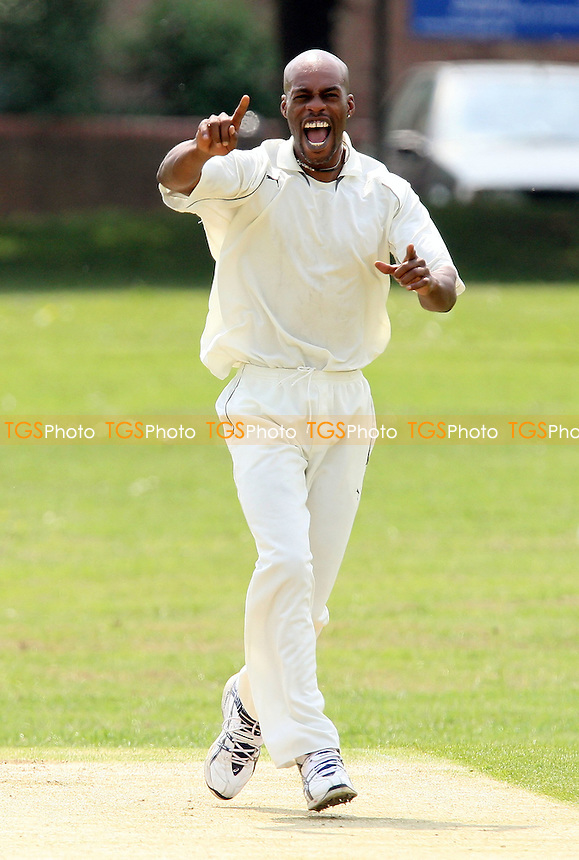 Ex-England cricketer Chris Lewis celebrates his first wicket for Ilford as D Robinson of Hornchurch is caught by K Darr - Hornchurch CC vs Ilford CC - Shepherd Neame Essex Cricket League Division One at Harrow Lodge Park, Hornchurch Road, Hornchurch, Essex - 10/05/08 - MANDATORY CREDIT: Gavin Ellis/TGSPHOTO. Self-Billing applies where appropriate. NO UNPAID USE. Tel: 0845 094 6026