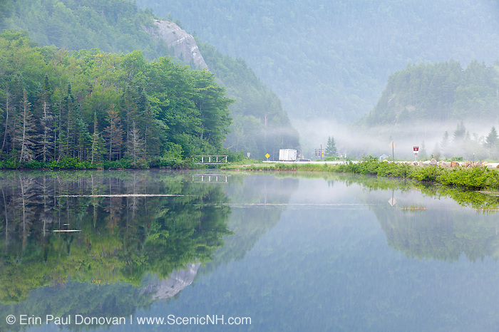 Reflection of Elephant Head rock profile in Saco Lake at the start of Crawford Notch State Park in Carroll, New Hampshire on a foggy morning.