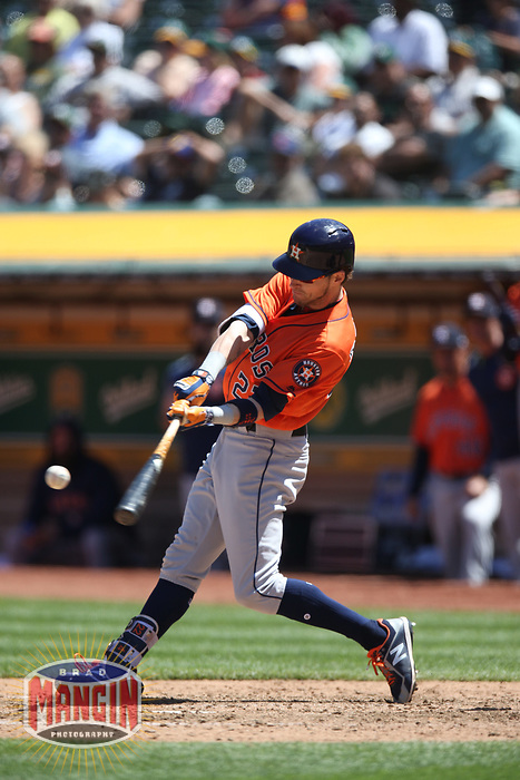 OAKLAND, CA - MAY 9:  Josh Reddick #22 of the Houston Astros bats against the Oakland Athletics during the game at the Oakland Coliseum on Wednesday, May 9, 2018 in Oakland, California. (Photo by Brad Mangin)