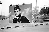 Jordan. At the jordano -iraqi border. Duty free shop sign. Portrait of King Abdullah II, wearing military clothes as high ranking Commander in chief of the Army. His Majesty King Abdullah II bin Al Hussein, is the actual King of The Hashemite Kingdom of Jordan.His Majesty King Abdullah II bin Al Hussein is the 43rd generation direct descendant of the Prophet Muhammad. He assumed his constitutional powers as Monarch of the Hashemite Kingdom of Jordan on February 7th, 1999.  © 2004 Didier Ruef