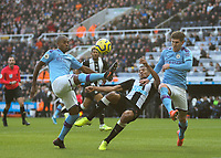 30th November 2019; St James Park, Newcastle, Tyne and Wear, England; English Premier League Football, Newcastle United versus Manchester City; Fernandinho of Manchester City clears the ball to deny Isaac Hayden of Newcastle United a shot on goal with John Stones of Manchester City close by - Strictly Editorial Use Only. No use with unauthorized audio, video, data, fixture lists, club/league logos or 'live' services. Online in-match use limited to 120 images, no video emulation. No use in betting, games or single club/league/player publications