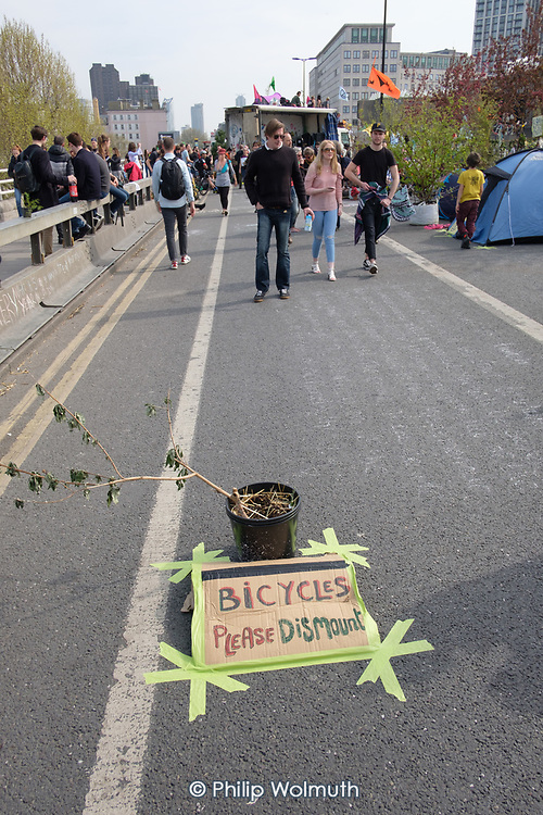 Bicycles Please Dismount.  Extinction Rebellion climate change campaigners occupy Waterloo Bridge, London.